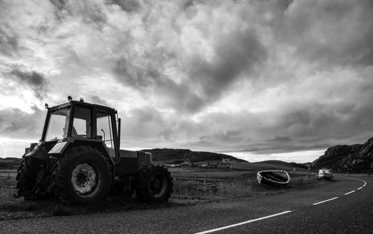 A Hebridean welcome--a tractor and some boats on land, empty roads and turbulent skies, that followed us where we went on these mysterious isles.