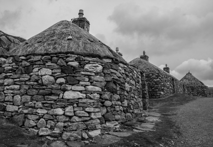 Blackhouses at Gearrannan village. These are centuries-old traditional crofters' houses, used for both livestock and people. Occupied till the 1970s, the blackhouses were given conservation status and preserved after their residents moved to more modern accommodation to avoid the difficult upkeep of drystone and thatchwork.