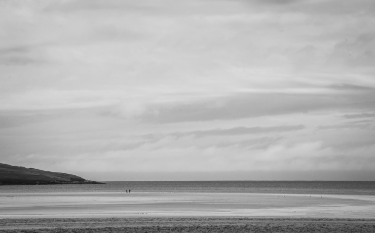 Two islanders take a walk on an empty stretch of Luskentyre beach on the Isle of Harris and make a minimalist photographer very happy.