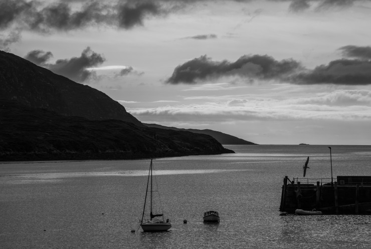 Dusk spreads across the sky over the harbour at Tarbert, the main town on the Isle of Harris.