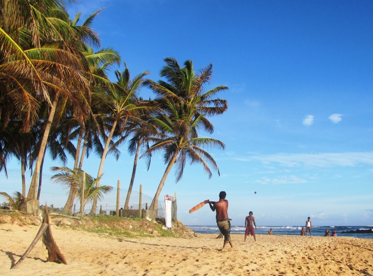 Local boys play a game of cricket at this popular Mirissa beach, almost empty of tourists in the low season.