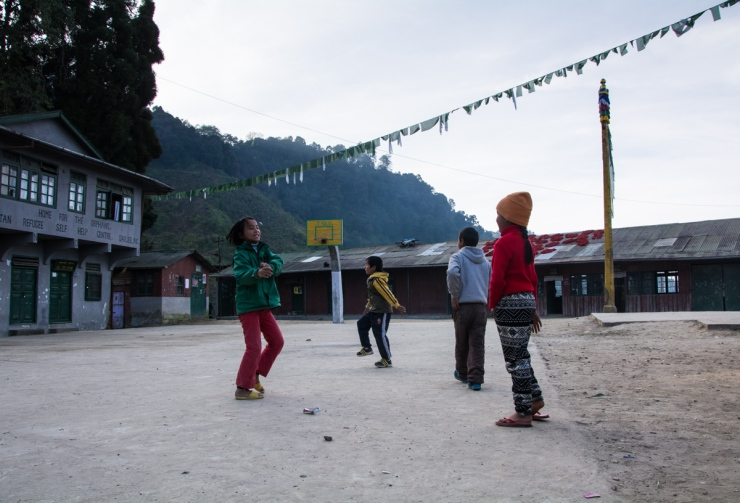 Children gather to play evening games at the Tibetan refugee village.