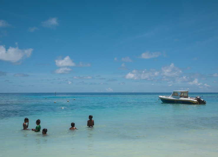 With the northern white sand beach cordoned off for tourists, local Maafushi boys use the waters by the harbour for swimming.