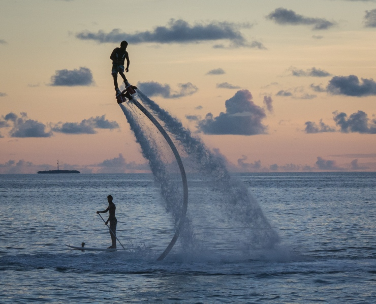 A Maafushi tourist rises high on his jet pack at sunset. Water sports are now a common sight in the island's north, an area dominated by tourists.